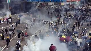 Hong Kong protesters hurt in drive-by fireworks attack