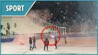 AEK Athens fans throw petrol bomb and fireworks at Ajax supporters