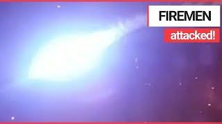 Horrifying footage shows moment a fire crew ATTACKED with fireworks | SWNS TV