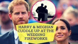 Harry & Meghan cuddle up at the wedding fireworks