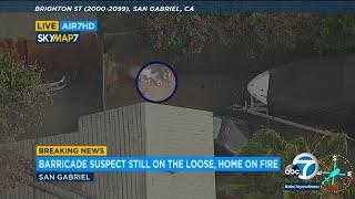 SAN GABRIEL BARRICADE: Armed suspect lights flames, fireworks amid standoff as 10 Fwy remains closed