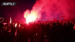 Red flares & fireworks | 'Men in Black' march against COVID-19 restrictions