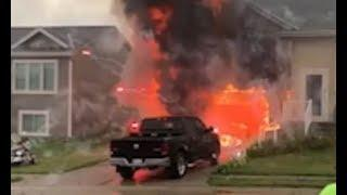 Fireworks explode out of a burning garage