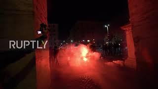 Italy: Fireworks let off, flares burn as police disperse anti-curfew protest in Rome