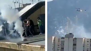 Italians launch fireworks at police helicopter as they flout coronavirus lockdown restrictions